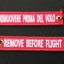 Portachiavi Ricamato REMOVE BEFORE FLIGHT – RIMUOVERE PRIMA DEL VOLO
